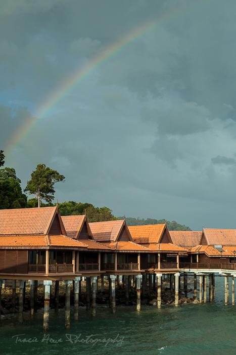 A rainbow over Berjaya Langkawi Resort .